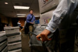 (364) Tyler Chafee watches as people drop off boxes of signatures for Petition 126 at the...