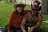 5232  Kathleen and Mark Hendrick have a drink with a friend while sitting in Civic Center Park in...