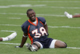#38 Anthony Alridge (cq) stretches before practice with the special teams at Denver Broncos...