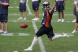 #2 Sam Paulescu (cq) punts the ball during special teams practice at the Denver Broncos Football...