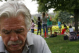 4530  Mike Z. sits under a tree in Civic Center Park as children from a local youth group play...