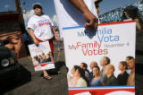 MJM313  Graciela Cabral (cq), left, waits along with other members of Mi Familia Vota for a press...