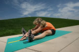 Carma Snapp and her kids, Ethan, 7, and Sheridan, 9, take the Presidential Fitness challenge...