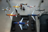 B3AE_SOUTH--Examples of theme painted planes are fly above the lobby of Southwest Airlines...