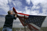 On US Highway 285 overpass at Sheridan Blvd, Frank Brown hung an US Flag Friday May 13th  He hung...