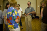 "Charles Harris (cq) does the ""your fly is open"" laughter exercise during laughing yoga..."
