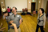 Charles Harris (cq) laughs during a laughing exercise at laughing yoga Monday, August 11, 2008, at...
