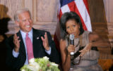 BG_0411 Vice Presidential candidate Joe Biden,left laughs as Michelle Obama speaks during a round...