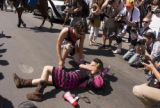 Paul Conrad photo Code Pink demonstrator Alicia Forrest gets help from a fellow demonstrator after...