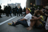 Keith Valentine, 20, (cq) of Denver, sits at the front of a group of impromptu anarchists with...