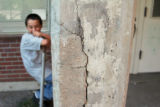 (201) Arthur Ramirez, 10, giggles watching his friends play Tuesday,  August 26, 2008, on the...