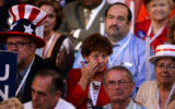 Rita Ferradino, Chairman of the Sarasota Democratic Party from Florida, wipes away a tear as she...