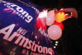After the polls closed workers like Jennifer Adams hurries to hang signs and balloons before the...