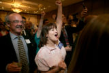 (seqn) Supporters John Barter, left, and Flora Rohrs, right,  cheer on Colorado Secretary of State...