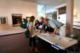 (PG624) Volunteers help Jane Stewart at the poll at the Boulder Public Library on Tuesday, August...