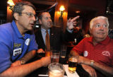 TUESDAY AUGUST 12TH, 2008 Mark Waller (center) watches the results with fellow supporters Dan...