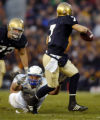 Air Force nose guard Ben Garland makes a diving sack on Notre Dame quarterback Jimmy Clausen...