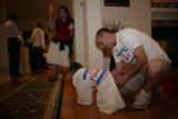Matthew Leebove (cq) puts a Joyce Foster t-shirt on his pug dog Sophie, (cq) during a campaign...