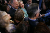 Sen. Hillary Rodham Clinton, flanked fellow Sen. Charles Schumer, watches as she releases her...