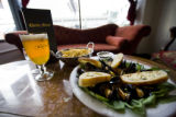 Mariniere Mussels in a white wine sauce for $11 and seasoned fries with Carolus golden beer are...