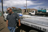 DM9708  Rudy Vigil with Rudy's Towing waits across the street from the Denver County Vehicle...