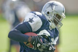 (seqn) Dallas Cowboys Terrell Owens runs after making a catch as they joing the  Denver Broncos to...