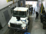 Scott Walters (cq), right, puts a 740 International hybrid truck  through tests, at NREL facility,...