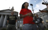 In front of the City and County Building members of Recreate 68- Glenn Spagnuolo, Larry Hales (at...