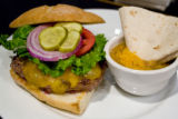 The famous all beef burger with cheddar cheese for $8.95 and a side cup of Green Chilli for $4.95...