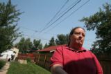 (072) Rosalie Asebedo, a neighbor to the slain Adams County prosecutor Sean May, talks with the...