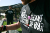 (seqn) Garett Reppenhagen, CQ, a member of the Iraq Veterans Against The War, wears his dog-tags...