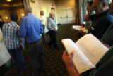 MJM523 Bidders keep an eye on prices while listening from the hallway during a Bureau of Land...
