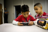 Juan Martinez, 8, (cq) (red) of Commerce City had his video game taken by a 19-year-old man. Rosa...