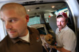 "(at right) Chris McGahey (cq), says goodbye to his dog ""Forrest"", as he is placed in a..."