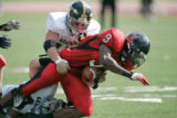 BG_0252 5A- Eaglecrest High School #9 Terell Thompson is tackled by Arapahoe  High School #13...