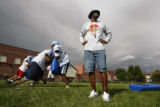 Coach Dwayne Davis keeps an eye on his team as they practice at Manual HS in Denver, Colo, on,...