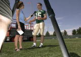 Billy Farris talks with press at the Colorado State University football practice field during...