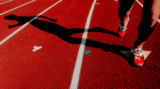 Heritage High School senior and 5a distance runner, Maddie McKeever (cq) cast a shadow on the...