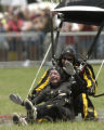 DJP103 - ** RETRANSMITTED FOR ALTERNATE CROP ** Former President George Bush parachutes to his...