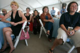 Lucky winners listen to Martha Stewart as she judges cupcakes as part of a birthday celebration...