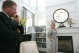 Jeffrey T. Mezger, President and Chief Executive Officer of KB Home, left,  watches as Martha...