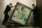 Parsons employees Luis Aguilera, left, and Margarito Campos move a relief map depicting the Dams...