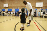 DM3355  Brandon Marshall pulls 5-year-old Bilei McAdams out of the crowd to talk about what she...