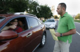 Social Studies teacher, Michael Hernandez gets a thumbs up from a parent - Jeff Robins after...