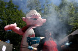 (PG3207) Shayne Johnson (cq) mans the grill at the Famous Dave's booth druing the Taste of...