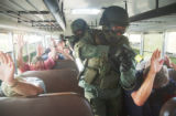 Routt County Sheriff's Office Sgt. Seth Merrick leads a SWAT team through a school bus Wednesday...