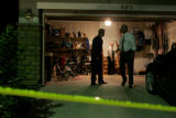 Police execute a search warrant inside the house where the two children lived who were found dead...