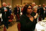 Lia Moran (cq), places her hand over her heart as the Colorado delegates pledge allegiance to the...