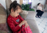 Three year old Melissa Duran sits in the home of relative Veronica Pallares (cq), June 1, 2005,...
