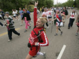 Amy Godlewski (cq), of Boulder, dances around on the course during the citizen's race at the 27th...